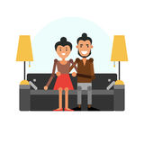 A young guy with a girl sitting on the couch. Loving couple Stock Image