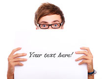 Young guy in glasses holding blank board Stock Photos