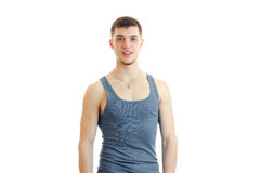 Young guy in the gray shirt posing on camera. A tall handsome young guy in the gray shirt posing on camera isolated on white background Stock Photos