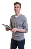 Young guy in a grey shirt with tablet computer Royalty Free Stock Photos