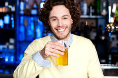 Young guy having chilled beer at bar Royalty Free Stock Photos