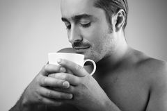 Young guy having a cup of coffee Stock Photography