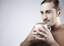Young guy having a cup of coffee Royalty Free Stock Photos