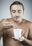 Young guy having a cup of coffee Royalty Free Stock Photography