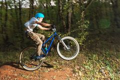 A young guy in a helmet flies landed on a bicycle after jumping from a kicker Stock Images