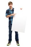 Young guy holding blank poster Stock Photos