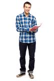 Young guy holding book Royalty Free Stock Photos