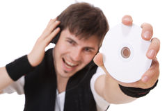 Young guy holding a compact disc Royalty Free Stock Photo