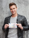 Young guy holding 50 euro note Stock Photography