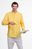 Young guy holding money. Royalty Free Stock Images