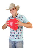 Young guy holding a red heart-shaped balloon Stock Image