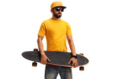 Young guy holding a skateboard. And looking at the camera isolated on white background Stock Photo