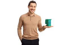 Young guy holding a small recycling bin and smiling Stock Photography