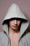 The young guy in a hood Stock Photography
