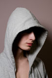 The young guy in a hood Royalty Free Stock Image