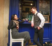Young Guy In Classic Suit Meets And Flirting Girl Near City Cafe In Old Town Royalty Free Stock Images