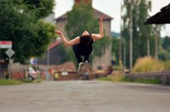 Young guy jumping backflip on the street Stock Photos