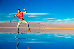 Young guy jumping on a exotic place in Atacama Desert, Chile Royalty Free Stock Photos