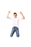 Young guy jumping from happiness Stock Photo