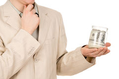 The young guy keep glass jar with the money Royalty Free Stock Photos