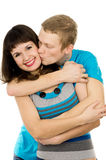 Young guy kisses the girl Royalty Free Stock Photo