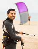 Young guy with kiteboard  at the beach Stock Images