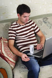 Young guy with a laptop Royalty Free Stock Photo