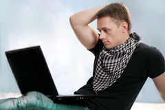 Young guy with laptop Royalty Free Stock Images
