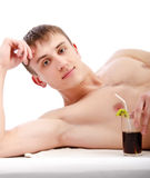 Young guy lie with glass in hand Royalty Free Stock Photo