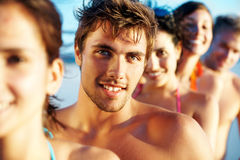Young guy in a line with group of friends Stock Photos