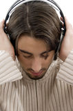 Young guy male enjoying music with headphones Stock Photography