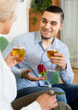 Young guy and mature woman drinking wine Stock Photography