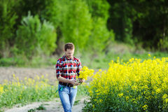 The young guy. On a meadow Royalty Free Stock Photos