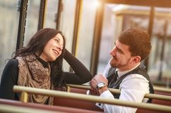 Young guy meets and talks to girl in tram public transport cabin royalty free stock image
