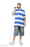 A young guy with a microphone isolated. Stock Photography