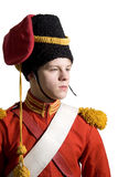 The young guy in the military form of red colour Royalty Free Stock Photos