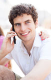 Young guy with mobile phone Stock Photography