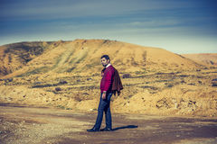 Young guy near a hill Royalty Free Stock Image