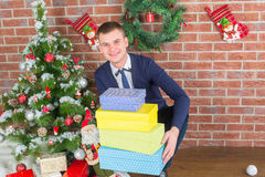 Young guy next to a Christmas tree Stock Photo
