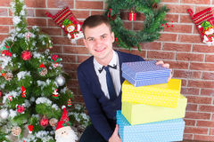 Young guy next to a Christmas tree Royalty Free Stock Photos
