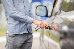 Hand on handle. Close-up of man opening a car door. stock photography