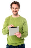 Young guy operating tablet device Royalty Free Stock Images