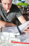 Young guy ordering in restaurant Royalty Free Stock Photos