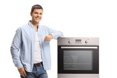 Young guy with an oven royalty free stock image