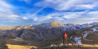 Young guy overlooks the mountainous surroundings of the village Royalty Free Stock Images