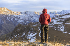 Young guy overlooks the mountainous surroundings of the village Royalty Free Stock Photography