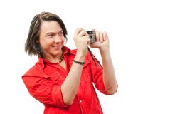Young guy photographs something. Royalty Free Stock Image