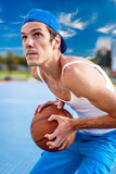 Young guy playing basketball. He is preparing to throw the ball Royalty Free Stock Photography