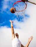 Young guy playing basketball. He is preparing to throw the ball Royalty Free Stock Photo