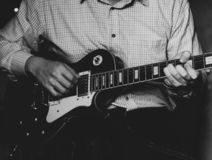 A young guy playing blues on an electric guitar. close-up. A young guy playing blues on an electric guitar. close-up stock images